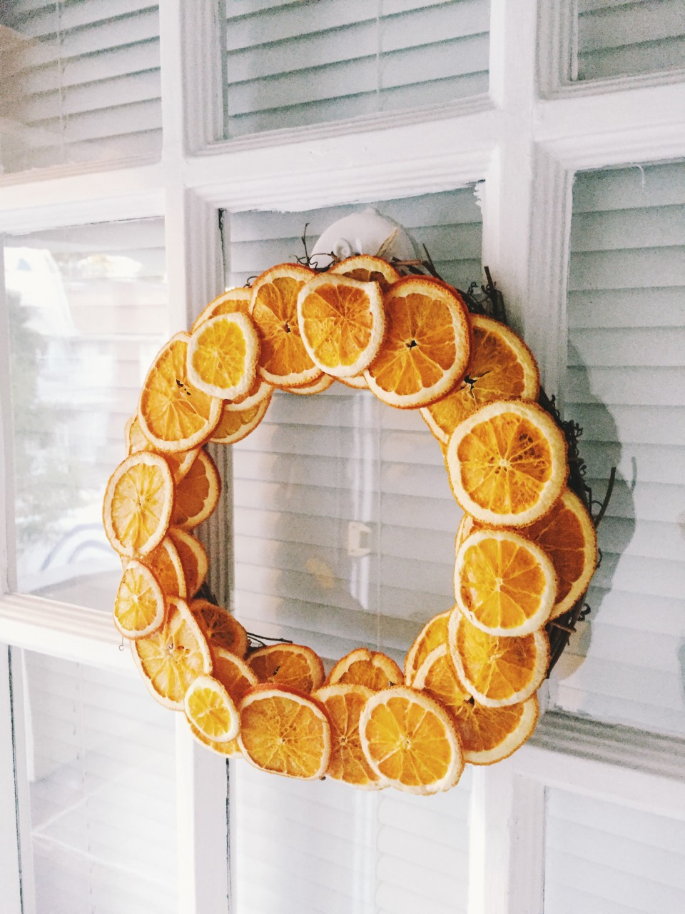 twine and table citrus wreath on the door